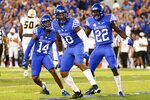 Kentucky defensive back Carrington Valentine (14), linebacker Jacquez Jones (10) and defensive back Yusuf Corker (22) celebrate stopping Missouri on third down during the first half of an NCAA college football game against Missouri in Lexington, Ky., Saturday, Sept. 11, 2021. (AP Photo/Michael Clubb)