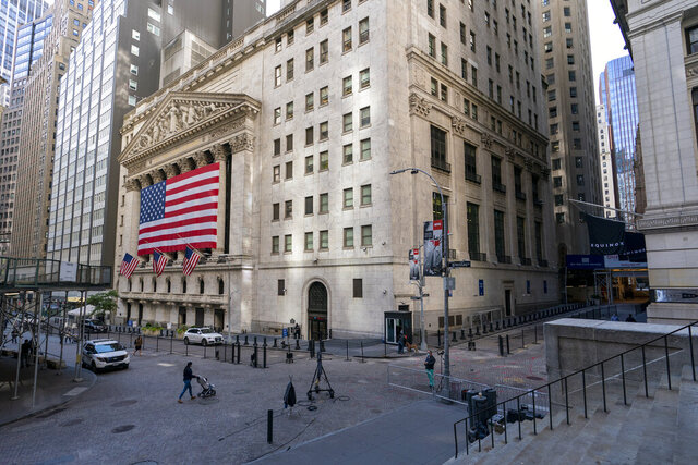 A giant American Flag hangs on the New York Stock Exchange, Monday, Sept. 21, 2020.  U.S. stock indexes are mixed in early trading Wednesday, as Wall Street's tumultuous month continues to churn.  (AP Photo/Mary Altaffer)