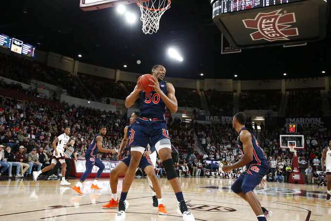 Auburn center Austin Wiley (50) pulls down a rebound against Mississippi State during the first half of an NCAA college basketball game, Saturday, Jan. 4, 2020, in Starkville, Miss. (AP Photo/Rogelio V. Solis)