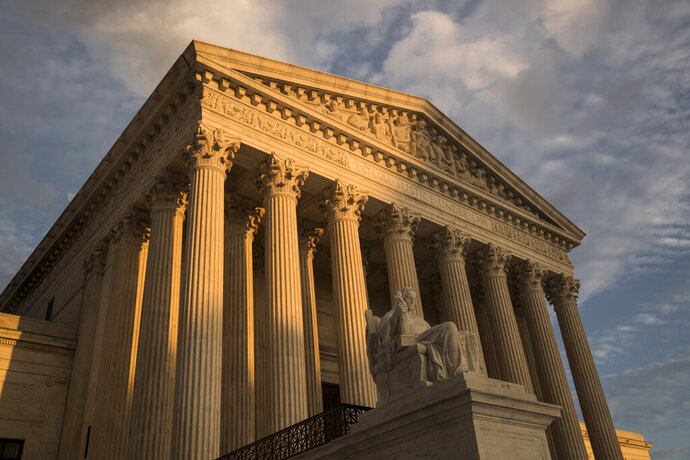 FILE - In this Oct. 10, 2017, file photo, the Supreme Court in Washington, at sunset. The Supreme Court has left in place a Kentucky law requiring doctors to perform ultrasounds and show fetal images to patients before abortions. The justices did not comment on Monday, Dec. 9, 2019, in refusing to review an appeals court ruling that upheld the law. (AP Photo/J. Scott Applewhite, File)