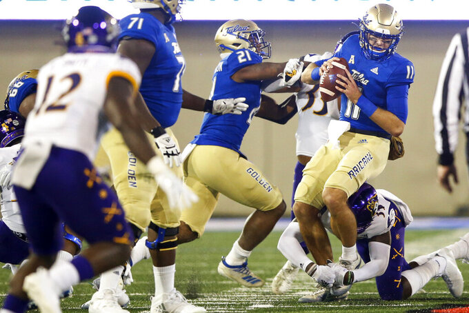 East Carolina defensive back Jireh Wilson (35) sacks Tulsa quarterback Zach Smith (11) during an NCAA college football game Friday, Oct. 30, 2020, in Tulsa, Okla. (Ian Maule/Tulsa World via AP)