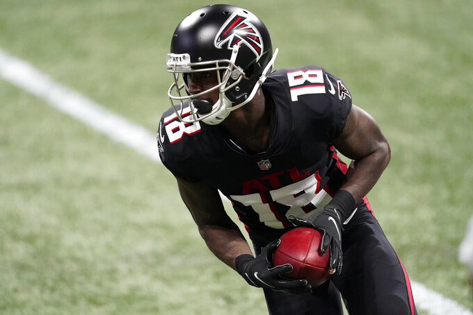 Atlanta Falcons wide receiver Calvin Ridley (18) runs after a catch against the Las Vegas Raiders during the first half of an NFL football game, Sunday, Nov. 29, 2020, in Atlanta. (AP Photo/John Bazemore)
