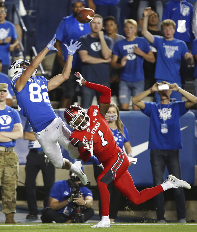 Utah defensive back Jaylon Johnson (1) breaks up a pass to BYU wide receiver Talmage Gunther (82) during the first half during an NCAA college football game Thursday, Aug. 29, 2019, in Provo, Utah. (AP Photo/George Frey)