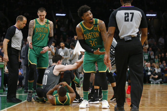 Boston Celtics guard Marcus Smart (36) complains about a jump-ball call to referee Mitchell Ervin (27) during the second half of the team's NBA basketball game against the Brooklyn Nets, Tuesday, March 3, 2020, in Boston. (AP Photo/Mary Schwalm)