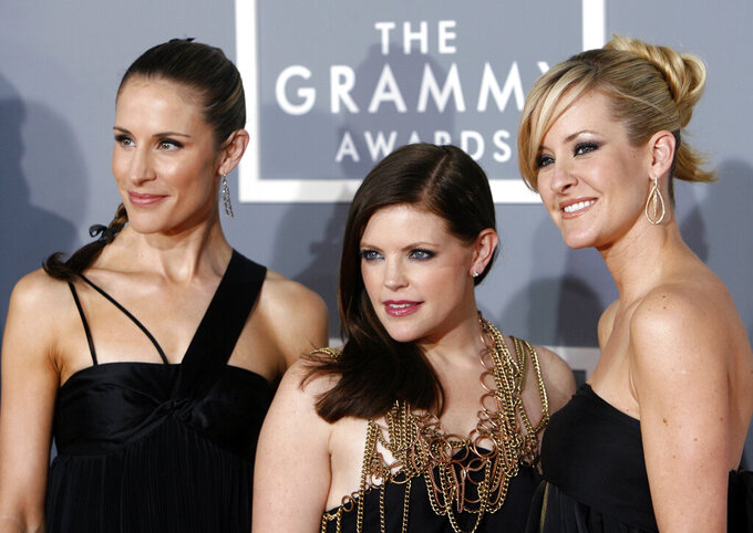 "FILE - In this Feb. 11, 2007 file photo, the Dixie Chicks, Emily Robison, left, Natalie Maines, center, and Martie Maguire arrive for the 49th Annual Grammy Awards in Los Angeles. The Grammy-winning country group, who recently changed their name to The Chicks, have a new album ""Gaslighter"" out July 17, 2020. (AP Photo/Matt Sayles, File)"