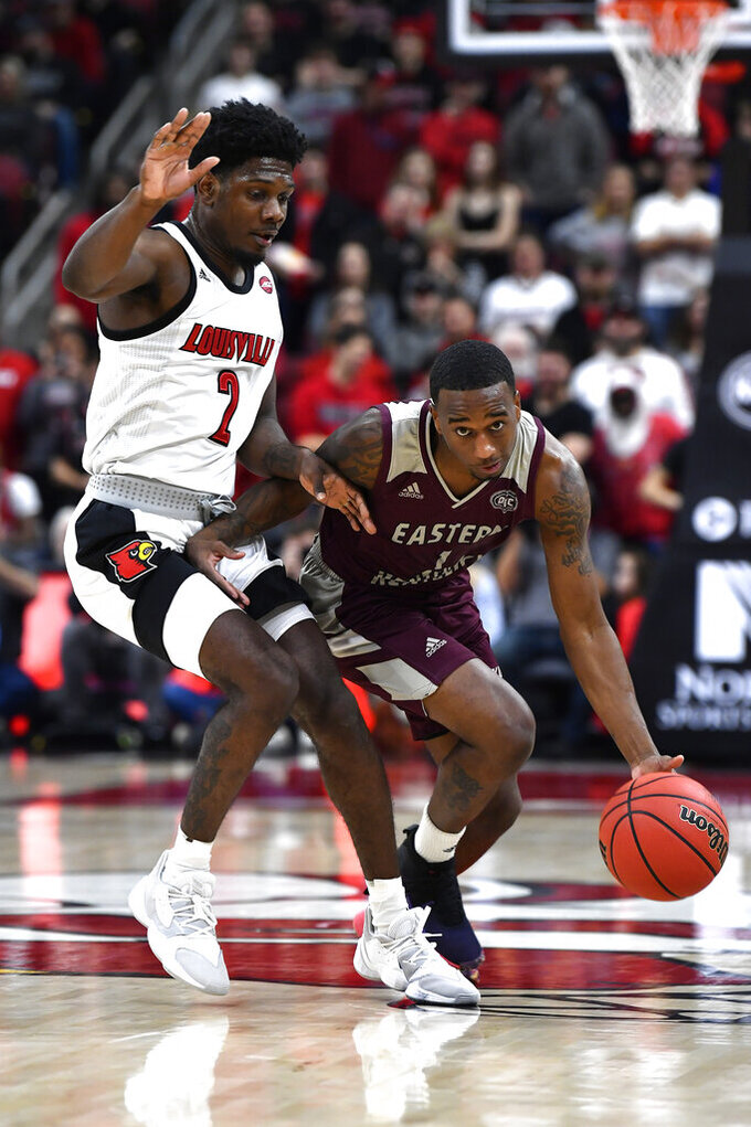 Eastern Kentucky guard JacQuess Hobbs (1) tries to get past the defense of Louisville guard Darius Perry (2) during the first half of an NCAA college basketball game in Louisville, Ky., Saturday, Dec. 14, 2019. (AP Photo/Timothy D. Easley)