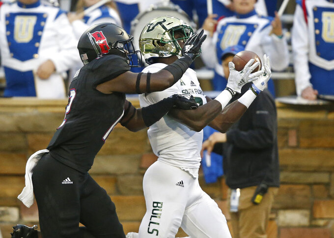 No. 23 USF rallies to beat Tulsa 25-24 to remain unbeaten