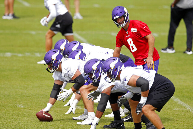 Minnesota Vikings quarterback Kirk Cousins (8) prepares for a pass play during the NFL football team's practice Friday, Aug. 14, 2020, in Eagan, Minn. (AP Photo/Jim Mone)