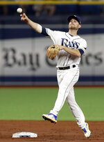 Tampa Bay Rays second baseman Brandon Lowe throws the ball but can't get Baltimore Orioles' Dwight Smith Jr. at first on an infield single during the third inning of a baseball game Tuesday, April 16, 2019, in St. Petersburg, Fla. (AP Photo/Chris O'Meara)