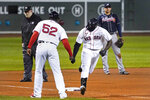 Boston Red Sox's Jackie Bradley Jr. is congratulated by third base coach Carlos Febles on his solo home run during the fourth inning of a baseball game against the Atlanta Braves, Wednesday Sept. 2, 2020, in Boston. (AP Photo/Charles Krupa)