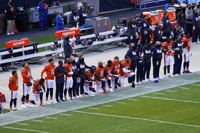 Chicago Bears players kneel during the national anthem before an NFL football game against the Indianapolis Colts, Sunday, Oct. 4, 2020, in Chicago. (AP Photo/Darron Cummings)