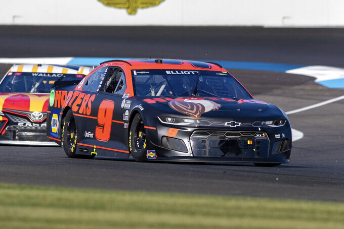 Chase Elliott (9) during qualifying for a NASCAR Cup Series auto race at Indianapolis Motor Speedway, Sunday, Aug. 15, 2021, in Indianapolis. (AP Photo/Doug McSchooler)