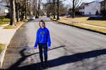 """Rebekah Bruesehoff, 14, poses for a portrait in New Jersey, Friday, Feb. 26, 2021. The transgender teenager competes on her middle school field hockey team and hopes to keep playing in high school. """"It's all been positive,"""" she said. """"The coaches have been really helpful."""" (AP Photo/Matt Rourke)"""