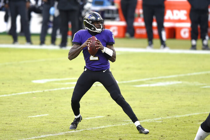 Baltimore Ravens quarterback Tyler Huntley looks to throw a pass against the Jacksonville Jaguars during the second half of an NFL football game, Sunday, Dec. 20, 2020, in Baltimore. The Ravens won 40-14. (AP Photo/Gail Burton)