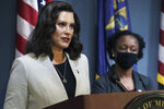 FILE - In this June 17, 2020, pool file photo provided by the Michigan Office of the Governor, Michigan Gov. Gretchen Whitmer speaks in Lansing, Mich. A federal appeals court late Wednesday, June 24, 2020, halted a lower judge's ruling and kept closed gyms and fitness centers that Whitmer ordered shut months ago to curb the coronavirus. (Michigan Office of the Governor via AP, Pool, File)