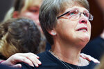 Kristine Young, mother of Ashley Young, reacts at the sentencing of Jared Chance in Kent County Circuit Court,  Thursday, Oct. 10, 2019, in Grand Rapids, Mich. Chance, a Michigan man convicted of killing and dismembering Ashley Young has been sentenced to at least 100 years in prison after a judge called his actions