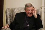 Cardinal George Pell has a light moment during an interview with the Associated Press inside his residence near the Vatican in Rome, Monday, Nov. 30, 2020. The pope's former treasurer, who was convicted and then acquitted of sexual abuse in his native Australia, said Monday he feels a dismayed sense of vindication as the financial mismanagement he tried to uncover in the Holy See is now being exposed in a spiraling Vatican corruption investigation. (AP Photo/Gregorio Borgia)