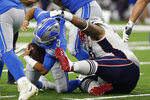 Detroit Lions quarterback Tom Savage (3) is sacked by New England Patriots defensive tackle Danny Shelton during the first half of a preseason NFL football game Thursday, Aug. 8, 2019, in Detroit. (AP Photo/Carlos Osorio)