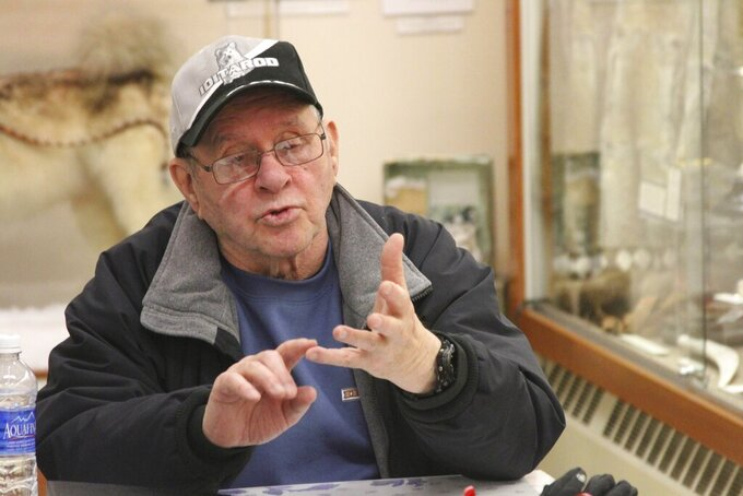 FILE - In this March 14, 2014, file photo, Howard Farley, who helped organize Nome as the end of the Iditarod Trail Sled Dog Race ahead of the first running in 1973, is seen at the Carrie M. McLain Memorial Museum in Nome, Alaska. The world's most famous sled dog race starts Sunday, March 7, 2021, without its defending champion in a contest that will be as much dominated by unknowns and changes because of the pandemic as mushers are by the Alaska terrain. (AP Photo/Mark Thiessen, File)