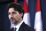 Prime Minister Justin Trudeau speaks during a press conference in Ottawa on Saturday, Jan. 11, 2020. Trudeau says Iran must take full responsibility for mistakenly shooting down a Ukrainian jetliner, killing all 176 civilians on board. (Justin Tang/The Canadian Press via AP)