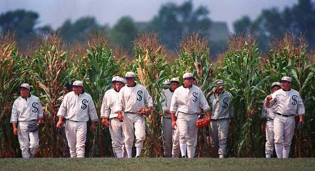 FILE - In this undated file photo, people portraying ghost players emerge from a cornfield as they reenact a scene from the movie