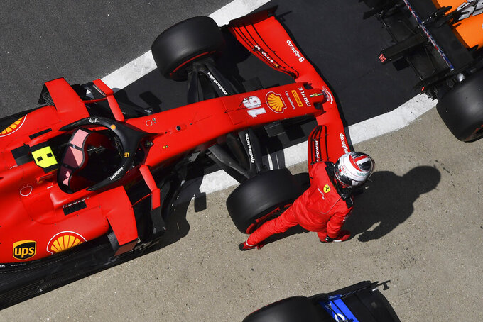 Ferrari driver Charles Leclerc of Monaco walks away from his car after finishing fourth in the qualifying session for the British Formula One Grand Prix at the Silverstone racetrack, Silverstone, England, Saturday, Aug. 1, 2020. The British Formula One Grand Prix will be held on Sunday. (Ben Stansall/Poolvia AP)