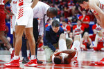 Dayton's Obi Toppin lies on the court with an apparent injury during the second half of an NCAA college basketball game against Massachusetts, Saturday, Jan. 11, 2020, in Dayton. (AP Photo/John Minchillo)