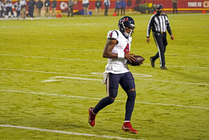 Houston Texans quarterback Deshaun Watson scores a touchdown on a 1-yard run against the Kansas City Chiefs in the second half of an NFL football game Thursday, Sept. 10, 2020, in Kansas City, Mo. (AP Photo/Charlie Riedel)
