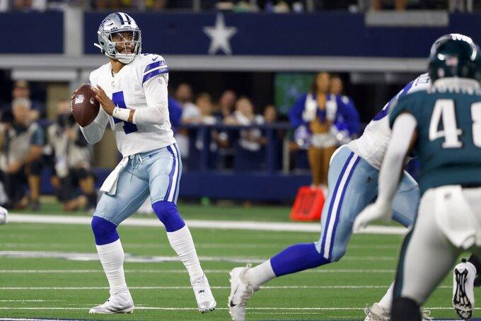Dallas Cowboys quarterback Dak Prescott (4) throws a pass in the first half of an NFL football game against the Philadelphia Eagles in Arlington, Texas, Monday, Sept. 27, 2021. (AP Photo/Ron Jenkins)