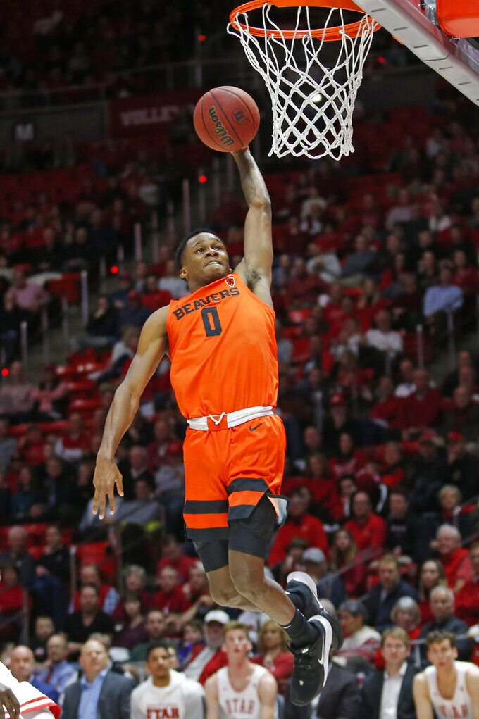 Oregon State guard Gianni Hunt (0) dunks against Utah in the first half during an NCAA college basketball game Thursday, Jan. 2, 2020, in Salt Lake City. (AP Photo/Rick Bowmer)
