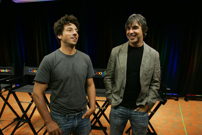 FILE - In this Sept. 2, 2008, file photo Google co-founders Sergey Brin, left, and Larry Page talk about the new Google Browser,