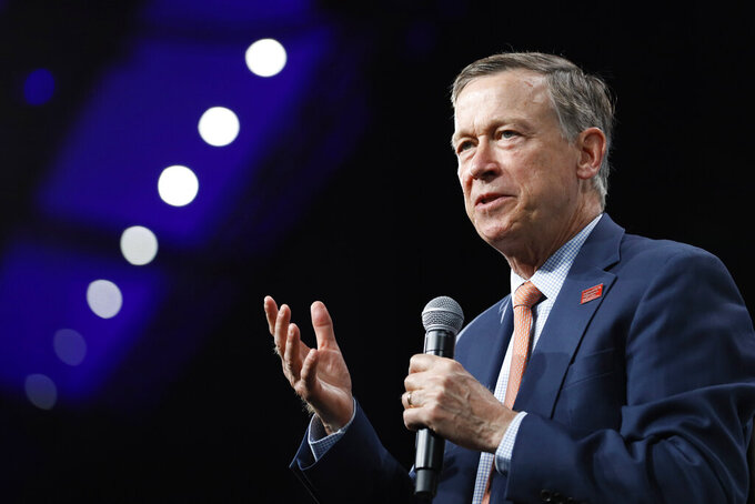 FILE - In this Aug. 10, 2019 file photo, then Democratic presidential candidate former Colorado Gov. John Hickenlooper speaks at the Presidential Gun Sense Forum in Des Moines, Iowa. Now a candidate for the U.S. Senate, Hickenlooper defended his record Friday, June 5, 2020 at a state ethics hearing about travel on private jets he took as Colorado governor, one day after the ethics panel found him in contempt for failing to appear. Hickenlooper rejected claims he violated Colorado law by accepting trips and insisted they either involved personal business or happened while he was touting Colorado's economy to potential investors during his 2011-2019 term. (AP Photo/Charlie Neibergall, File)