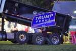 A supporter of President Donald Trump campaigns at a busy intersection during rush hour along Route 228 in Cranberry Township, Pa., on Friday, Oct. 16, 2020. To win Pennsylvania, President Donald Trump needs blowout victories and historic turnout in conservative strongholds across the state. (AP Photo/Gene J. Puskar)