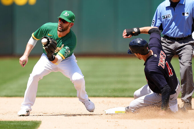 Cleveland Indians' Bradley Zimmer (4) beats the tag of Oakland Athletics second baseman Jed Lowrie, left, to steal second base in the fifth inning of a baseball game Sunday, July 18, 2021, in Oakland, Calif. (AP Photo/Tony Avelar)