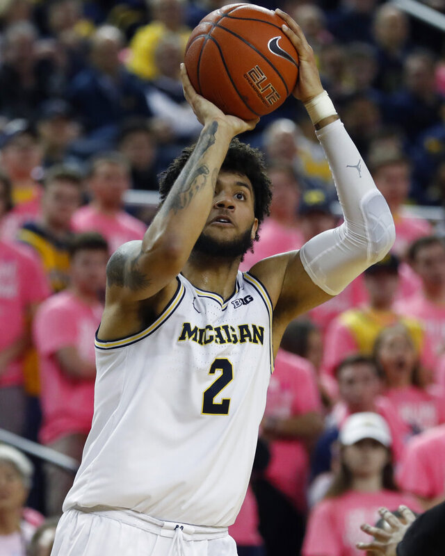 Michigan forward Isaiah Livers shoots during the second half of the team's NCAA college basketball game against Wisconsin, Thursday, Feb. 27, 2020, in Ann Arbor, Mich. (AP Photo/Carlos Osorio)