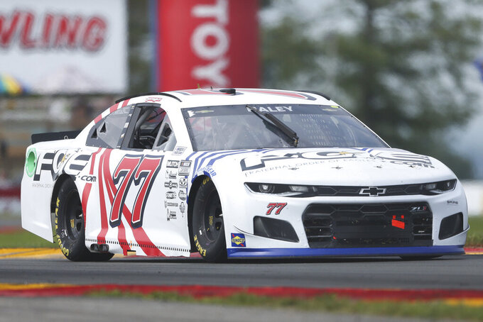 Justin Haley drives through the Bus Stop during a NASCAR Cup Series auto race in Watkins Glen, N.Y., on Sunday, Aug. 8, 2021. (AP Photo/Joshua Bessex)