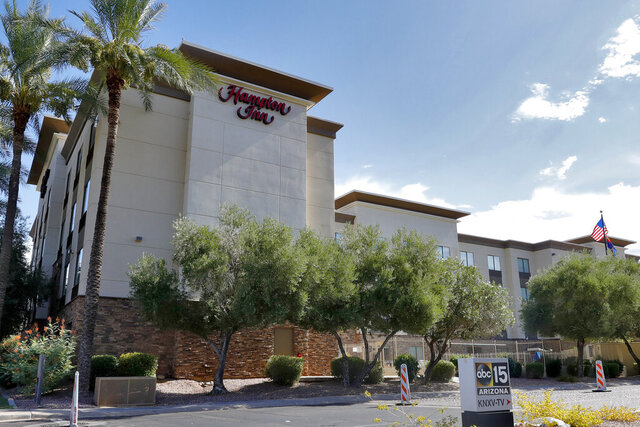 FILE - In this July 21, 2020, file photo, a Hampton Inn is shown in Phoenix. The Trump administration is detaining immigrant children in hotels before deporting them to their home countries. About 8,800 unaccompanied children have been quickly expelled from the United States along the Mexico border under a pandemic-related measure that effectively ended asylum. The disclosure came Friday, Sept. 11, 2020, in the government's appeal of an order to stop using hotels for long-term detention of children. (AP Photo/Matt York, File)