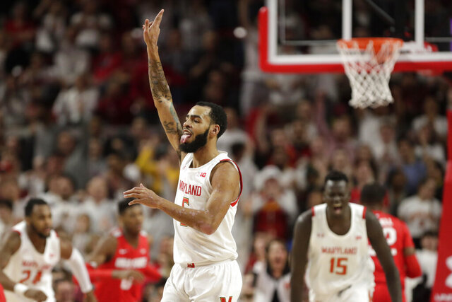Maryland guard Eric Ayala gestures after scoring a basket against Ohio State during the first half of an NCAA college basketball game, Tuesday, Jan. 7, 2020, in College Park, Md. (AP Photo/Julio Cortez)