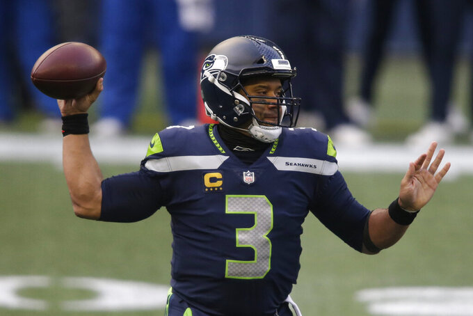 Seattle Seahawks quarterback Russell Wilson (3) passes against the Los Angeles Rams during the first half of an NFL football game, Sunday, Dec. 27, 2020, in Seattle. (AP Photo/Scott Eklund)