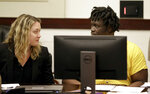 Emanuel Samson, right, talks with an attorney during a hearing Wednesday, Feb. 20, 2019, in Nashville, Tenn. Samson is accused of fatally shooting a woman and wounding six other people at a Tennessee church in September 2017. (AP Photo/Mark Humphrey)