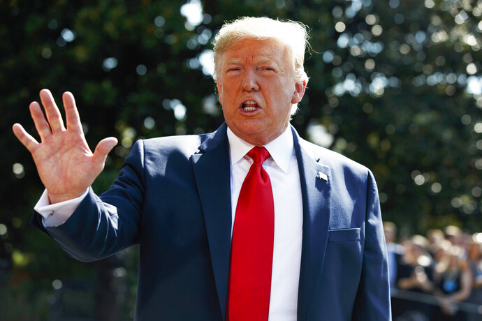President Donald Trump talks to reporters on the South Lawn of the White House, Friday, Aug. 9, 2019, in Washington, as he prepares to leave Washington for his annual August holiday at his New Jersey golf club.  (AP Photo/Evan Vucci)