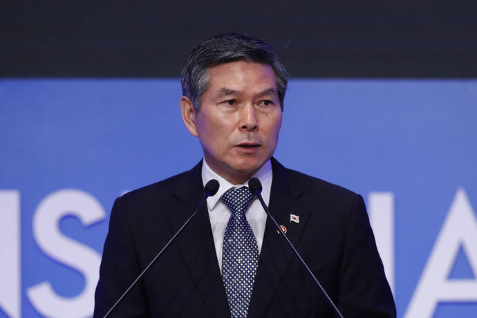 In this Sept. 5, 2019, photo, South Korean Defense Minister Jeong Kyeong-doo delivers a speech during the opening ceremony of the Seoul Defense Dialogue in Seoul, South Korea. Jeong said Tuesday, Dec. 10, 2019 that North Korea's recent unspecified weapons test was of a rocket engine, amid speculation the North was making preliminary steps toward a prohibited long-range rocket launch. (AP Photo/Lee Jin-man)