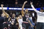 Gardner-Webb forward Eric Jamison Jr. (2) celebrates after a score against Virginia during a first-round game in the NCAA men's college basketball tournament Friday, March 22, 2019, in Columbia, S.C. (AP Photo/Sean Rayford)