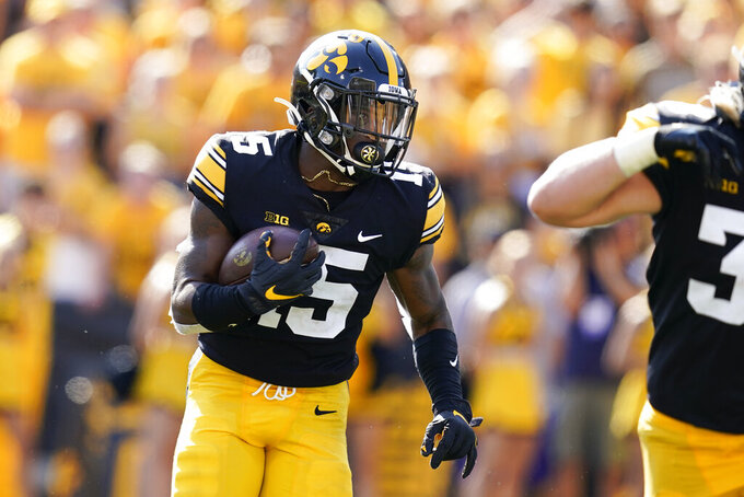 Iowa running back Tyler Goodson (15) carries the ball up filed during the first half of an NCAA college football game against Kent State, Saturday, Sept. 18, 2021, in Iowa City, Iowa. Iowa won 30-7. (AP Photo/Charlie Neibergall)