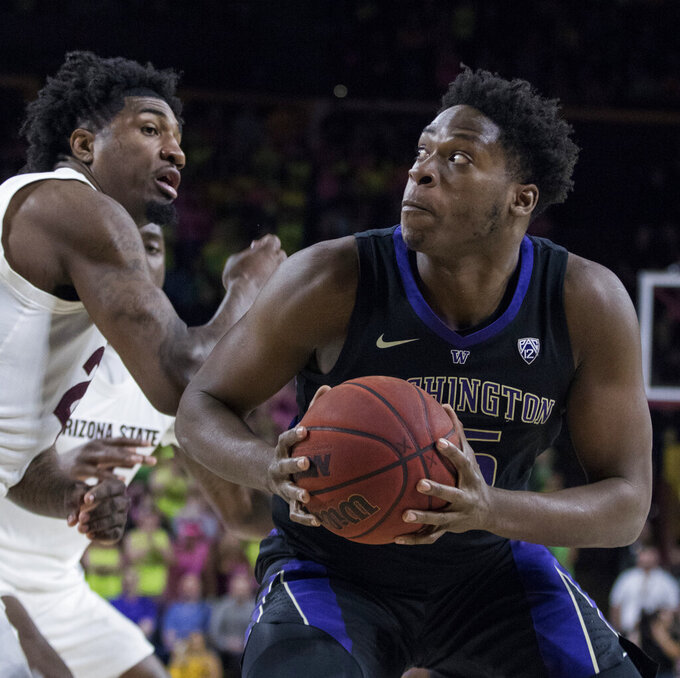 Washington's Noah Dickerson (15) eyes the basket as Arizona State's Romello White defends during the first half of an NCAA college basketball game Saturday, Feb. 9, 2019, in Tempe, Ariz. (AP Photo/Darryl Webb)
