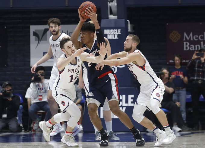 Gonzaga forward Rui Hachimura, center, is defended by Saint Mary's guard Tommy Kuhse, left, and guard Jordan Ford during the second half of an NCAA college basketball game in Moraga, Calif., Saturday, March 2, 2019. (AP Photo/Jeff Chiu)