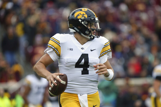 Iowa quarterback Nate Stanley looks to pass during an NCAA college football game against Minnesota, Saturday, Oct. 6, 2018, in Minneapolis. (AP Photo/Stacy Bengs)