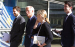 European Union chief Brexit negotiator Michel Barnier, second left, waits outside of EU headquarters in Brussels for the arrival of Irish Foreign Minister Simon Coveney, Friday, Sept. 27, 2019. Michel Barnier is meeting with Irish Foreign Minister Simon Coveney and UK Brexit secretary Stephen Barclay seeking a way to unblock the stalled negotiations on Britain's withdrawal from the bloc. (AP Photo/Virginia Mayo)