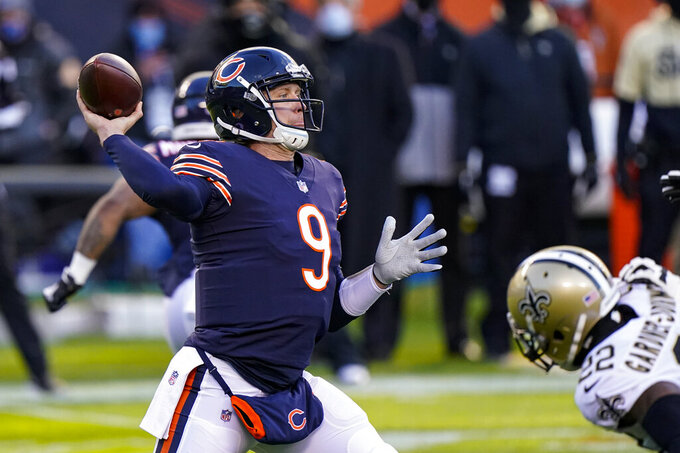Chicago Bears quarterback Nick Foles (9) throws against the New Orleans Saints in the first half of an NFL football game in Chicago, Sunday, Nov. 1, 2020. (AP Photo/Nam Y. Huh)