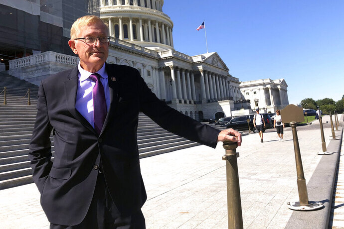 Rep. Paul Cook, R-Calif., poses for a photo outside the U.S. Capitol in Washington, Thursday, Sept. 19, 2019. Cook served 26 years as a Marine, earning two Purple Heart medals for combat wounds suffered in Vietnam. But amid his seventh year in Congress, the aching and discouraged California Republican has decided he's endured enough (AP Photo/Alan Fram)